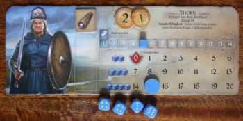 Auf der Heldentafel werden Gegenstände abgelegt und die Kampfstärke ermittelt.