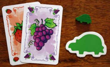 Spielzubehör des grünen Spielers.