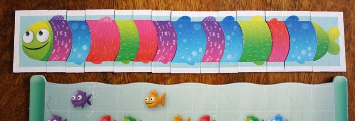 Der Fisch passt nicht mehr in das Aquarium - der Spieler gewinnt.