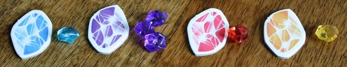 Jeder Spieler erhält die Steine seiner Plättchenfarbe.