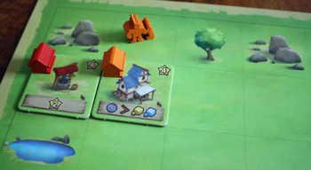 Der Spieler erhält Rohstoffe und kann auch bis zu zwei Gebäude nutzen.