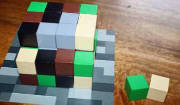 Der Spieler nimmt sich einen Smaragd- und einen Sandblock.
