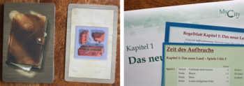 Der Gebäudekartenstapel und der erste Umschlag.