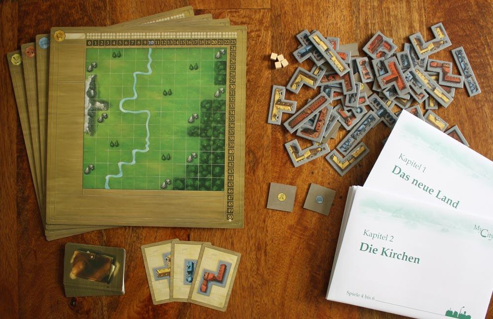 Das Spielzubehör von My City vor dem Öffnen des ersten Kapitels.