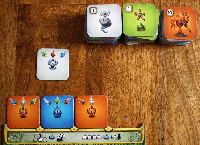 Der Spieler kann das Plättchen aus der Auslage oder vom Nachziehstapel nehmen.