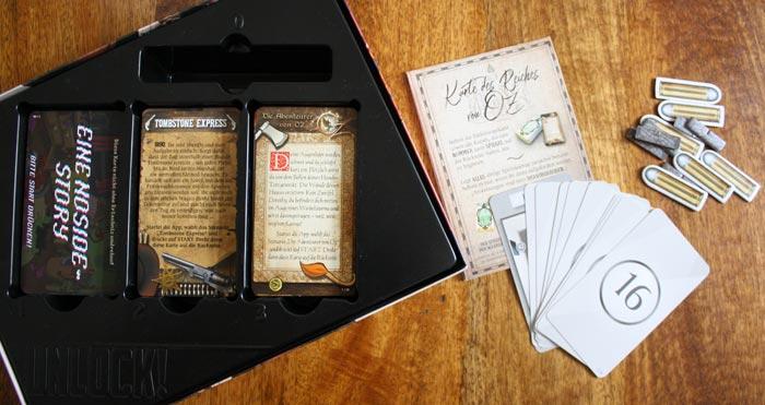Spielzubehör der Unlock! Secret Adventures Box.